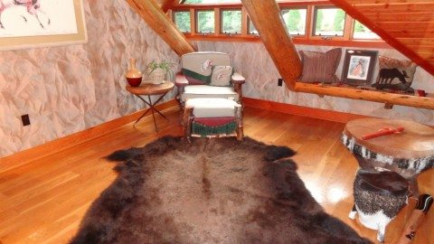 animal-skin-rug-in-log-home