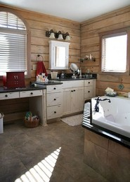 antique-white-cabinets-tile-floor-tile-tub.jpeg