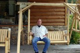 The Blue Ridge line of porch swings sold at Rocky Top Log Furniture & Railing.