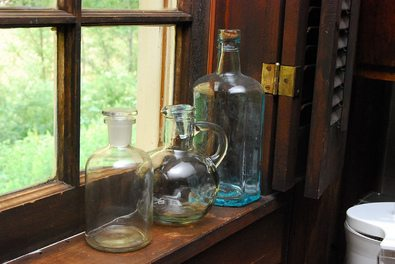 clear-glass-bottles-on-windowsill-by-district-47.jpg