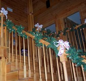 garland-laced-stairs-in-log-home.jpg