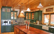 green-painted-cabinets-in-kitchen.jpg