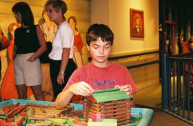 kid-building-lincoln-logs-cabin-by-Caomai.jpg