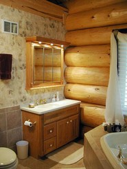 log-bathroom-with-wallpaper-tiled-wall.jpg