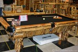 This pool table would be perfect inside a log home!