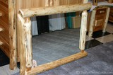 A log framed mirror from Lonesome Cottage Log Furniture Company.