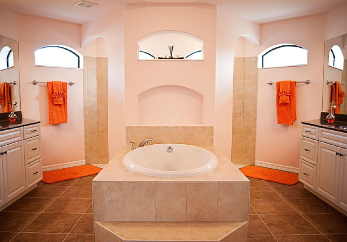 This is one master bathroom design that features a floating wall to separate the doorless walk-in shower from the rest of the bathroom.