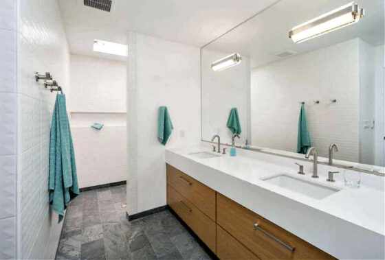 A large walk-in shower without any doors in the master bathroom.