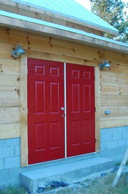 red-steel-doors-on-log-building-by-Justin-Shearer.jpg