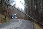 semi-truck-dodging-power-lines-and-downed-trees.jpg