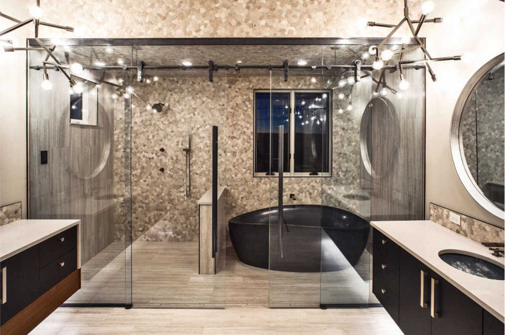 A master bathroom wet area - the walk-in shower and bathtub are both enclosed in a glass 'room'.