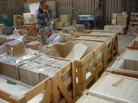 shrink-wrapping-travertine-tile-at-factory-by-MarcMac.jpg