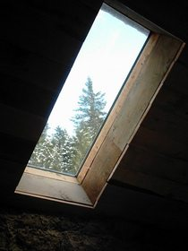 skylight-in-log-cabin-loft-by-rabbie.jpg