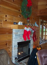 stockings-hung-over-fireplace-mantel-log-home.jpg