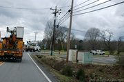 utility-trucks-turning-onto-pinewood-in-leipers-fork.jpg