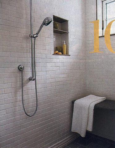 A nice spa shower inside the master bathroom -- with a built-in shower seat and niche shelf for hair products.