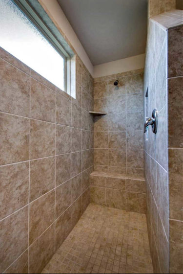 Another tiled walk-in shower without a door - as seen when touring homes for sale.