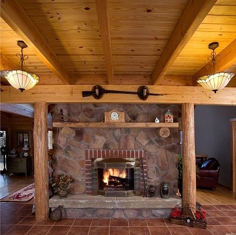 Pictures of rustic columns poles inside log homes for 4 sided fireplace