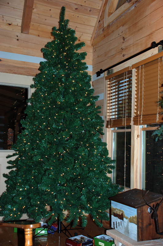 bare christmas tree inside log homejpg - Homes Decorated For Christmas On The Inside