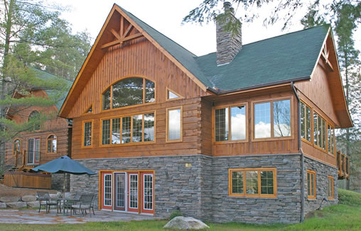 Pictures of stone accents used in log homes the log home for Stone and log homes