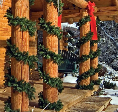 garland laced columns log homejpg - Cabin Christmas Decor