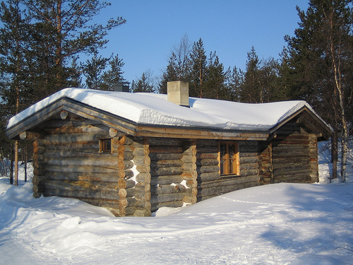 log cabin in the snow. photo by ezioman on Flickr.