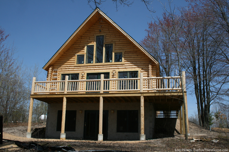 Log home staining issues tips for ongoing log home for Log home plans with basement