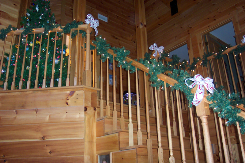 Log Cabin Homes Adorned With Holiday Lights & Christmas Decorations