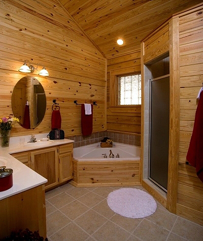 log home bathroom with nice tub, shower, and countertops.